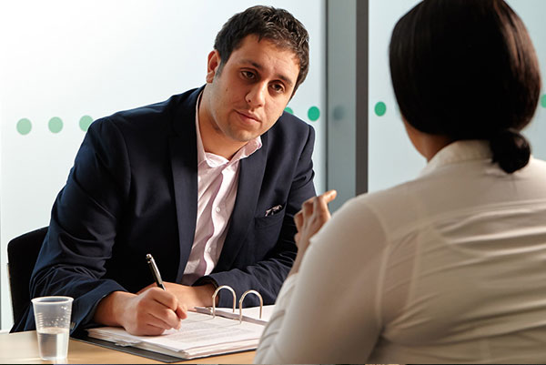 a man talking to a lawyer