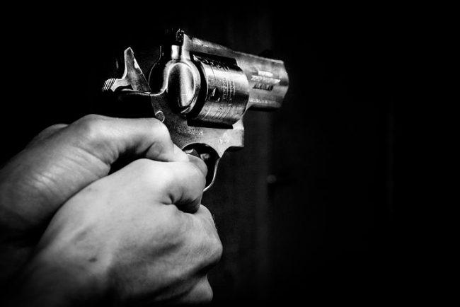 hand firing a gun