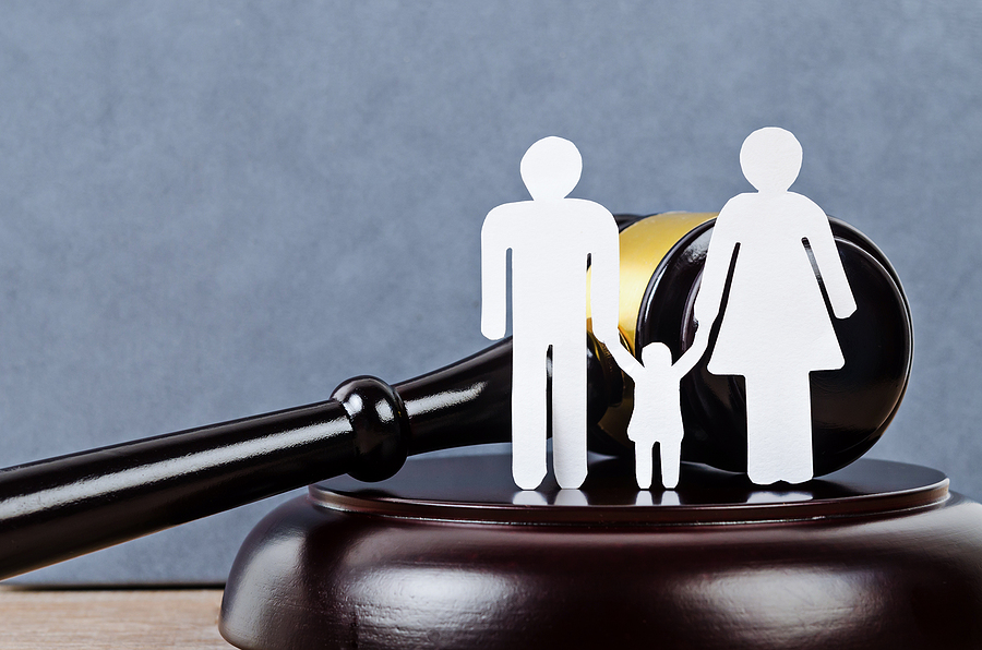 Family figure and a gavel in the table. Family court in Sydney concept