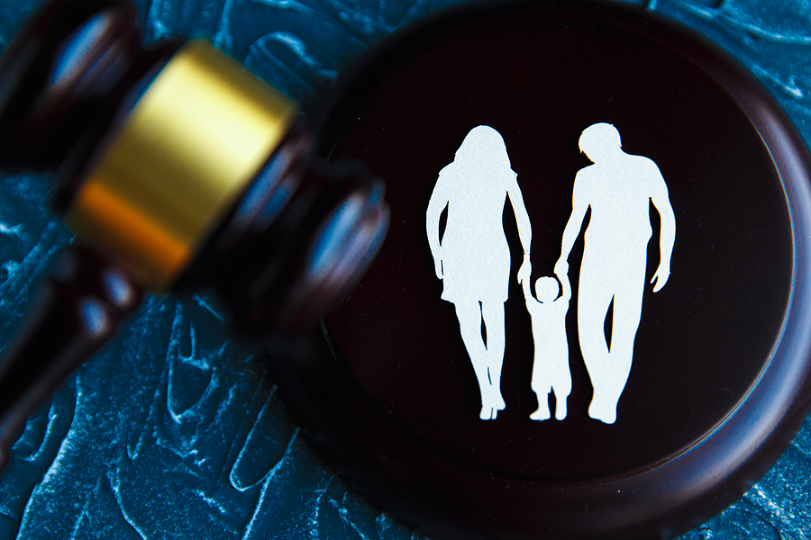 Gavel and a picture of a family . Family Law concept